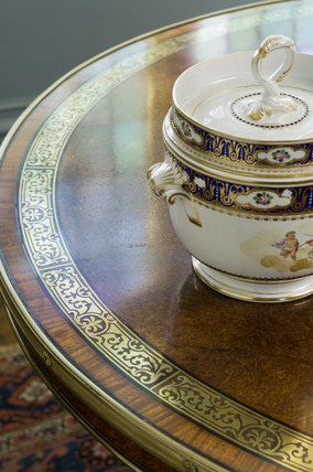 The Amboyna wood centre table in the Drawing Room at Coughton Court, Warwickshire
