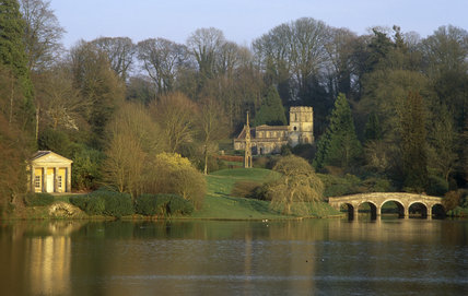 The Temple of Flora, St Peter's Church, the Bristol High Cross and the Palladian Bridge at Stourhead, Wiltshire in winter