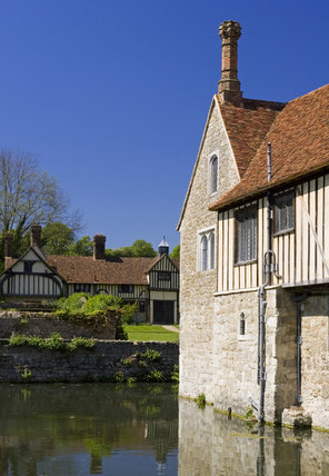 The South Front at Ightham Mote, Sevenoaks, Kent, a fourteenth-century moated manor house, with the cottages in the distance
