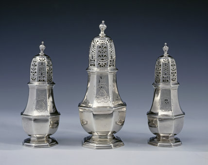 A set of three George I sugar casters by Charles Adams, 1718, (DUN.S.43) part of tthe silver collection at Dunham Massey, photographed for the Country House Silver book.