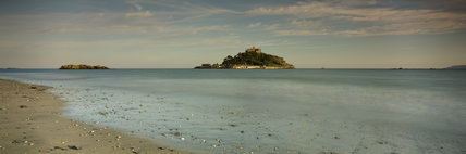 St. Michaels Mount a magical island with a medieval castle, the home of the St.Aubyn family for over 300 years, was originally the site of a Benedictine Priory approached by causeway or boat.