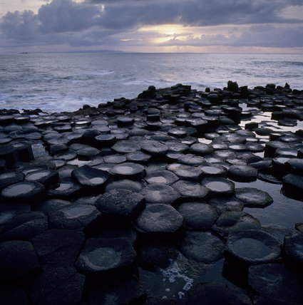 The Giant's Causeway, looking out over the sea the sun breaking through the clouds In Search of Neptune, page 117