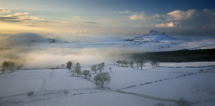 A misty, snowy panoramic view looking to Roseberry Topping