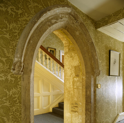 The fourteenth century stone arch which leads to the staircase landing outside the State Bedroom at Clevedon Court