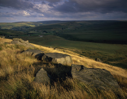 Close view of gritstone slabs at Buckstones Moss looking south-east across the valley towards Pule Hill on the Marsden Moor Estate