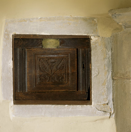 Detail of the carved bookpress or cupboard in an alcove in the Study at Woolsthorpe Manor
