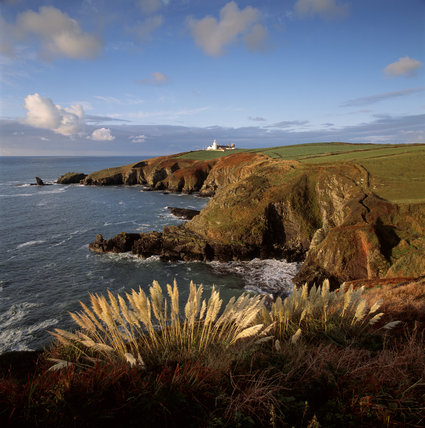 The Lighthouse at the Lizard Peninsula with Bumble Rock and the Lions Den