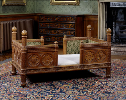 A child's bed made by James Plucknett, adapted from Viollet- le-Duc's Dictionnaire raisonne du mobilier francais 1872-75, at Tyntesfield,