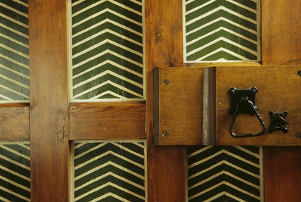 Detail of the chevron design painted on the door at the end of the ground floor gallery leading to the Pilgrim's Rest at Red House,1859, designed by Phillip Webb for William Morris