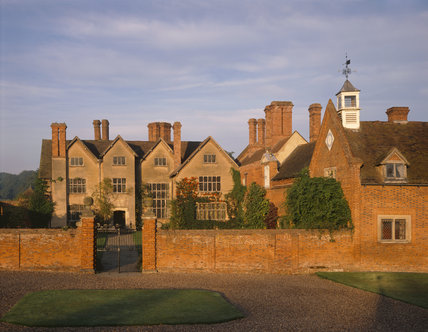 The exterior of Packwood House, originally a Tudor timber-framed house it was largely rebuilt in brick and rendered over in the mid seventeenth and twentieth centuries