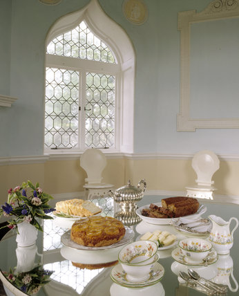 The Garden Room with a variety of food and utensils laid out on the table