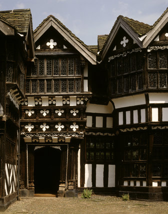 The inner courtyard at Little Moreton Hall revealing the doorway of the porch leading into the Great Hall