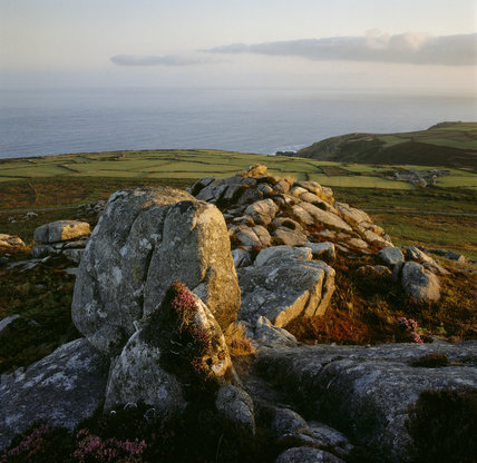 Looking north from the summit of Carn Galver, Cornwall,  over fields towards the sea