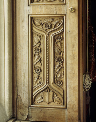 Detail of the shutters in the Drawing Room, with carving by James Plucknett, at Tyntesfield