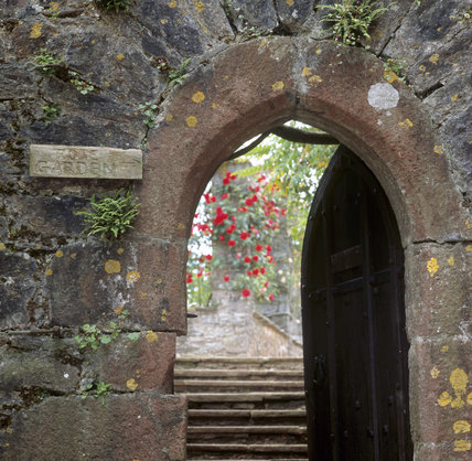 The stone archway leading to the walled Rose Garden at Compton Castle