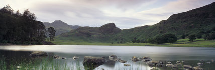 Blea Tarn and Langdale Pikes, view from the edge of the tarn with grasses and rocks to the fore, hills beyond