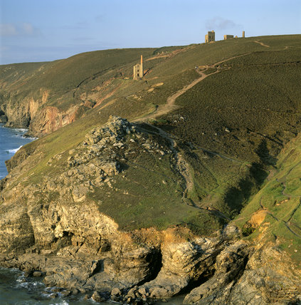 A view along the cliff to the disused mines of Towanroath and Wheal Coates in the background