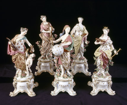 Close view of Chelsea Gold Anchor porcelain figures of five of the nine Muses, c 1765, in the Long Gallery at Upton House