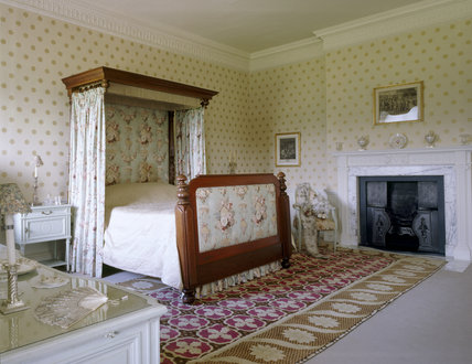 The Corner Bedroom at Berrington Hall showing Victorian half- tester bed from Sherborne Park with a coverlet said to have been used by Queen Anne of Denmark, wife of James I