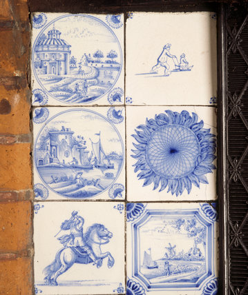 Delftware blue and white tiles in the fireplace in the Dining Room at Red House