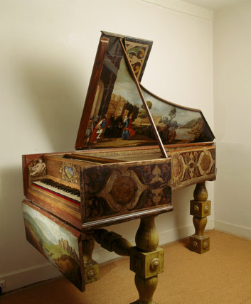 A richly decorated Italian Harpsichord in the South-East Room of Fenton House, which is part of the Benton Fletcher collection of keyboard instruments