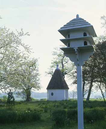 The Gazebo or summerhouse at Sissinghurst designed in 1968 and dedicated to Harold Nicholson after his death, with a dovecote in front and fields beyond