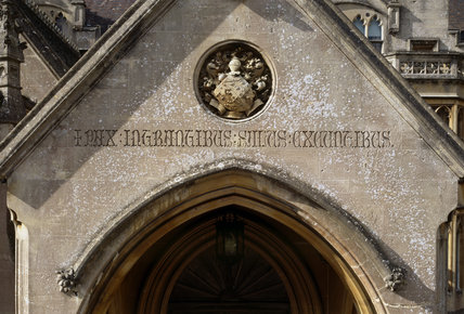 The East Entrance porch to the house at Tyntesfield with the motto 'Peace for those who enter comfort for those who leave' carved in Latin over the doorway