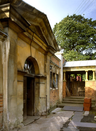 Oblique view of an arched gateway to the Garden Building and wood store at Tyntesfield a Victorian estate near Bristol