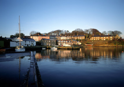 Warm afternoon light on the houses of Strangford village at the edge of the water