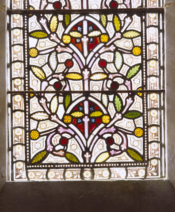 Close up of floral design in a stained glass window at the Chapel at Tyntesfield