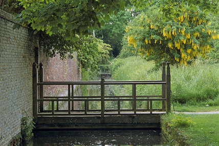 View of the old wooden bridge across the moat at Barrington Court