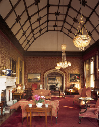 Room view of Drawing Room at Tyntesfield with its barrel vaulted ceiling, looking east to the open doors to the Ante Room showing its ornate fireplace