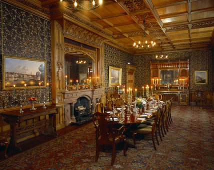 The Dining Room at Tyntesfield, a view towards the wooden, carved ornate buffet and fireplace
