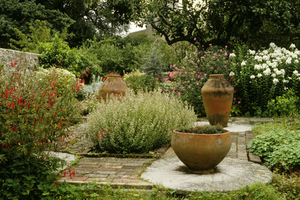 Walled garden at Monk's House with garden pots