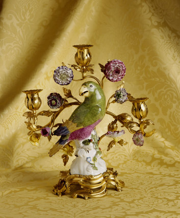 A ceramic parrot mounted on a Louis XV ormolu base candlestick, From the Drawing Room at Fenton House