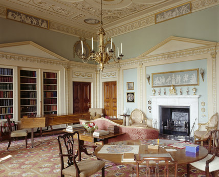 The Library at Berrington Hall has fitted bookcases designed to resemble classical facades with shallow pediments & delicate Ionic pilasters united by a frieze of square Greek key pattern