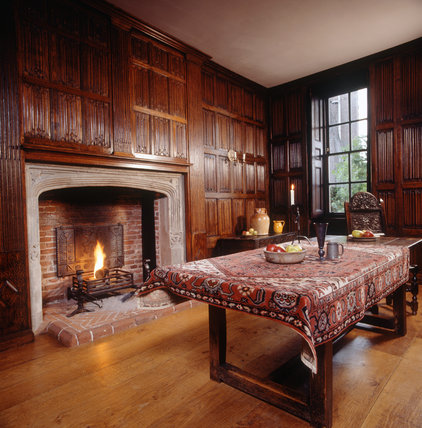 Room view of the Linenfold Chamber towards the fireplace showing the wooden table and carved wooden chairs