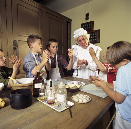Children making gentlemen's and ladies' soap in the Butler's Pantry at Dunham Massey