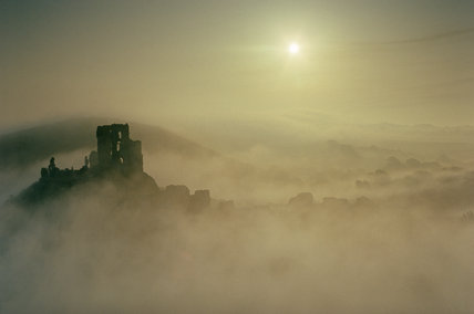 A view of Corfe Castle from the west hill at dawn