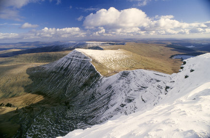 Breacon Beacons view across mountains under snow showing Cribyn from Pen-Y-Fan