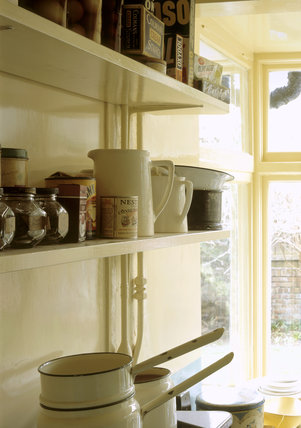 The Kitchen at Mendips showing the shelves above the cooker containing jars and cooking ingredients from the 1960s