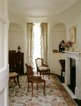 View towards the window in the Boudoir at Llanerchaeron, with an early C19th mahogany cupboard on the left