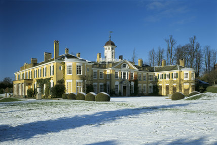 Polesden Lacey, the entrance front seen from across the lawns under heavy snow