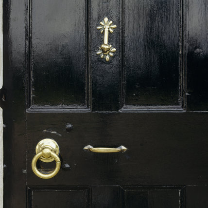 close-up of a door at Springhill, showing the highly polished fittings