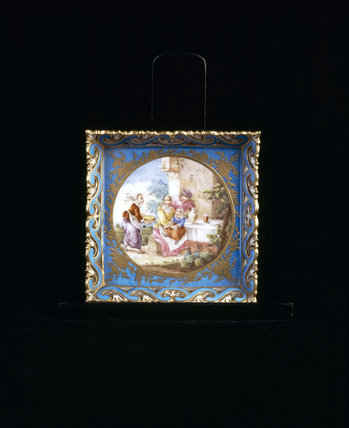 Close view of Sevres Bleu Celeste Square Plateau with perforated sides, depicting a woman and children in a rural setting, painted in the manner of Teniers, at Upton House,