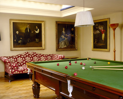 The Billiard Room at Upton House with view of good part of the billard table, and paintings of Rev