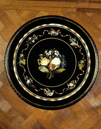 Close view from above of inlaid round table top in the Drawing Room at Dunster Castle