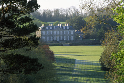 A distant view of the north front of Antony, an 18th-century mansion set in parkland, Torpoint, Cornwall