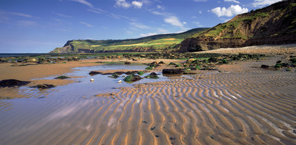 A view of Ravenscar (NT) from the beach at Boggle Hole (NT)