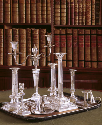 A collection of silver candlesticks dating from 1698 to 1900 by Syngin, Willaume, Both, and others at Saltram